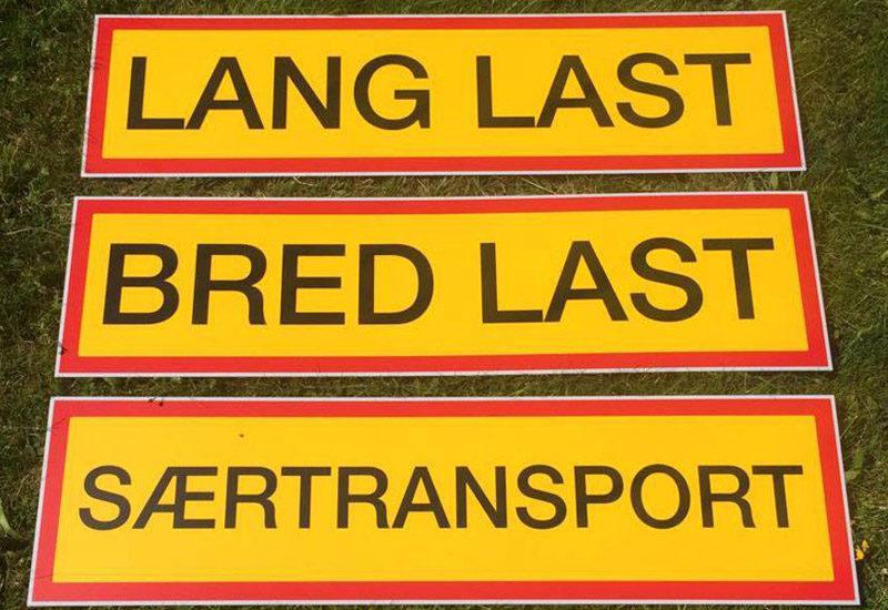 Tekst på gul frontplade - bred last - lang last